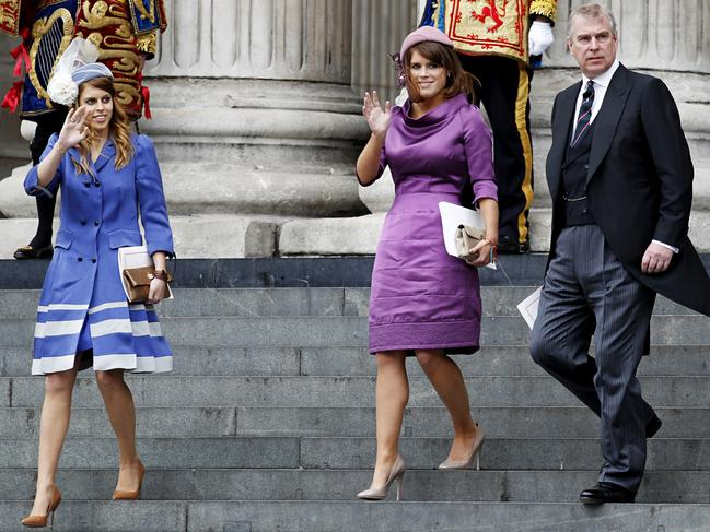 Prince Andrew with his two daughters, Princesses Beatrice (left) and Eugenie. Picture: AFP/ Ian Kington.