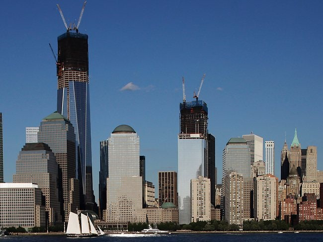 Construction cranes perch on top of One World Trade Center, left, and Four World Trade Center in New York. Eleven years after terrorists attacked the World Trade Center, the new World Trade Center now dominates the lower Manhattan skyline.