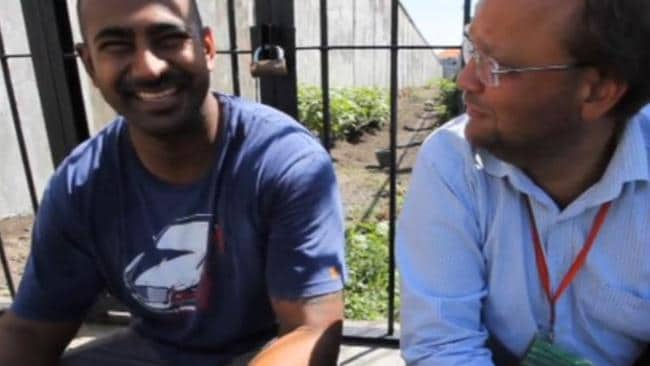 Staying positive ... Myuran Sukumaran even manages to crack a smile during the video.