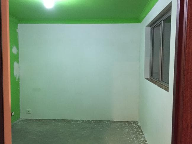 The renovation began with a plasterer hired to render the brick walls in Billy's new room.