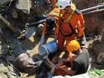 Search and rescue workers help rescue a person trapped in rubble following an earthquake and tsunami in Palu, Central Sulawesi, Indonesia September 30, 2018 in this photo taken by Antara Foto. Picture: Antara Foto/Darwin Fatir/via REUTERS