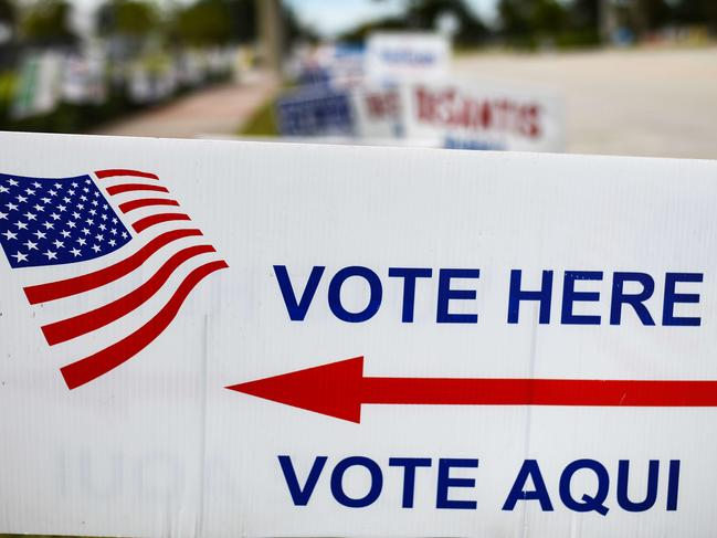 Signs point to a polling station on South Central Avenue in Apopka, Florida. Picture: Jeff J Mitchell/Getty Images/AFP