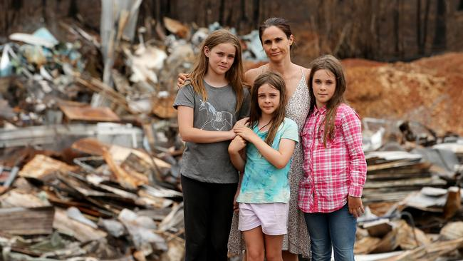 Kate Sutton with her daughters Zoe Hatton, 12, Jada Hatton, nine, and Tyler Hatton, 10, who escaped the blaze that flattened their school in Bobin.