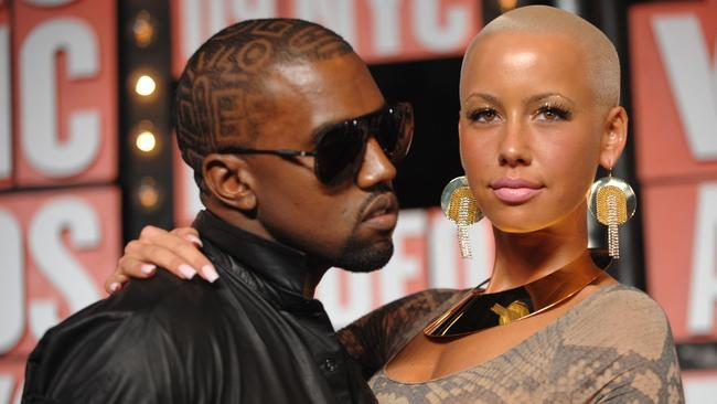 Kanye West in 2009 and his then girlfriend, Amber Rose.
