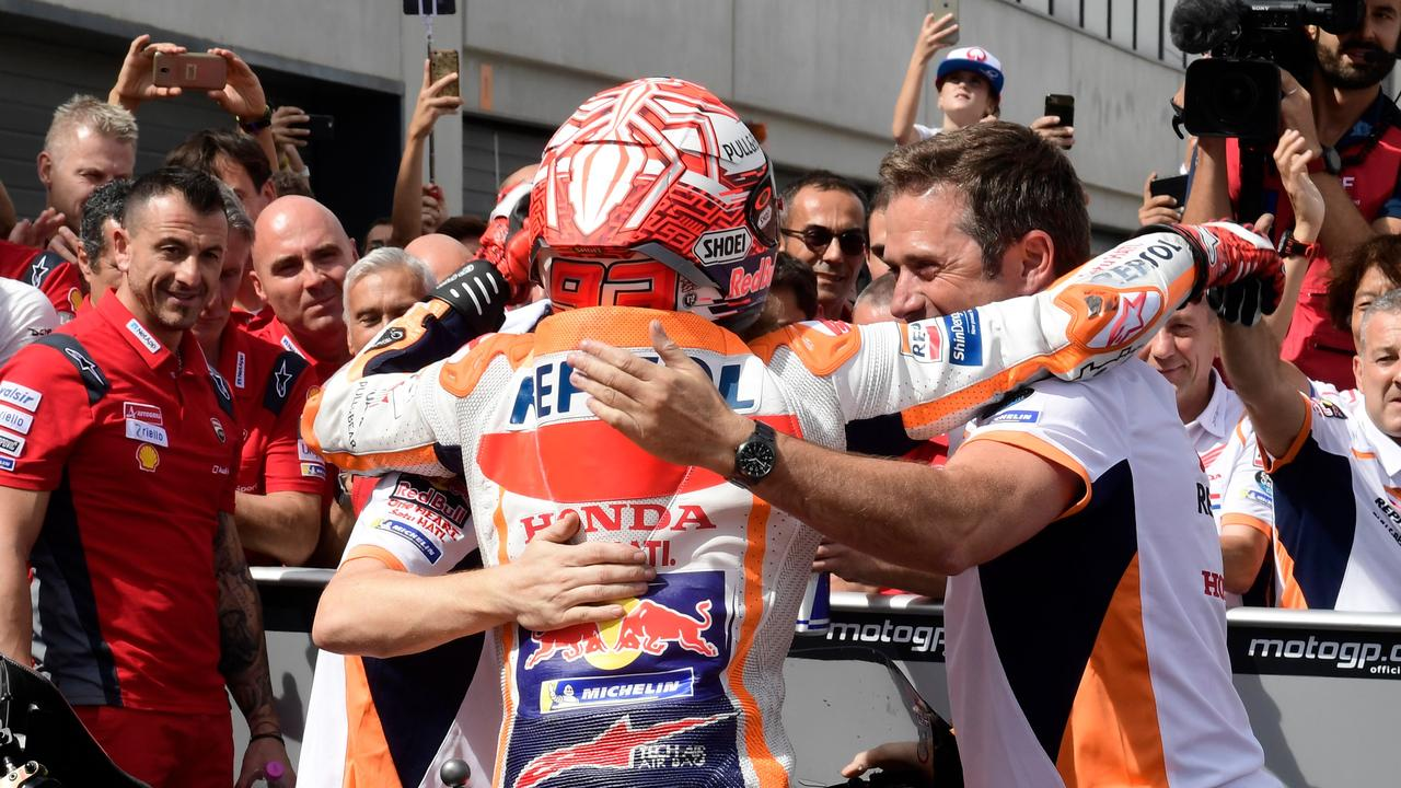 Marquez celebrates with staff after winning the race in Aragon.