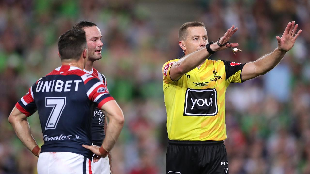 Referee Ben Cummins sends Cooper Cronk #7 of the Roosters to the sin bin
