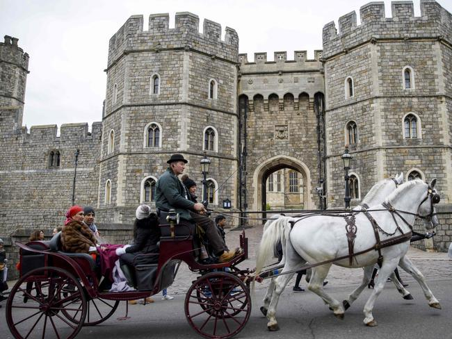 The carriage Meghan and Prince Harry use might have more gold on it than this one. Picture: AFP/Tolga Akmen