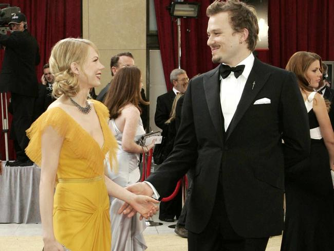 Oscar nominees ... Michelle Williams (L) dances on the red carpet with her fiance Heath Ledger (R), nominated as best actor for the film 'Brokeback Mountain'. Picture: Supplied
