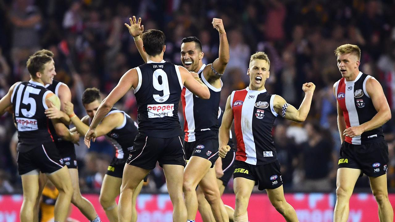 The Saints celebrate after beating Hawthorn at Marvel Stadium on Sunday.