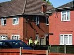 Police officers stand on duty outside a house in Fallowfield, Manchester, in northwest England on May 23, 2017, as they search the resdiential property following the May 22 deadly terror attack at the Ariana Grande concert. Picture: AFP