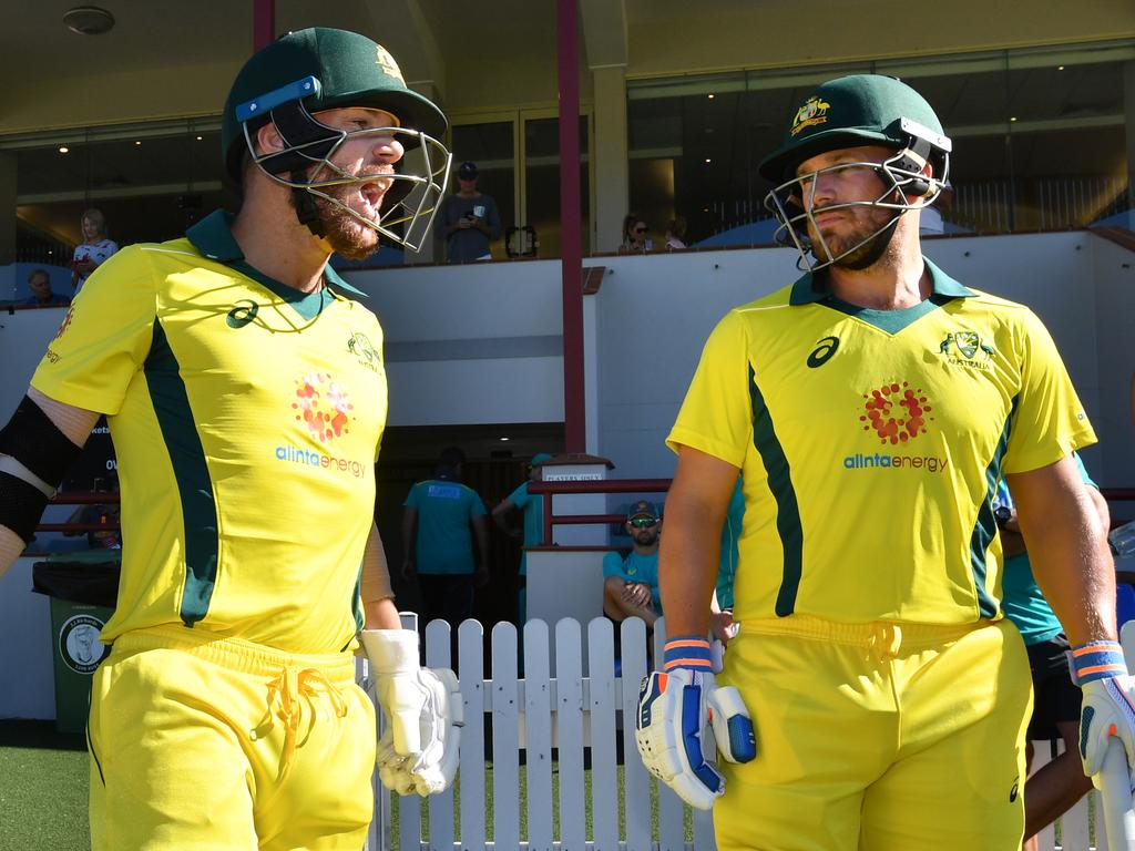 David Warner (left) and Aaron Finch (right) of the Australia XI are seen walking out to bat at the start of the Australia XI innings during the One-Day cricket practice match before the World Cup between the Australia XI and New Zealand XI at Allan Border Field in Brisbane, Wednesday, May 8, 2019. (AAP Image/Darren England) NO ARCHIVING, EDITORIAL USE ONLY