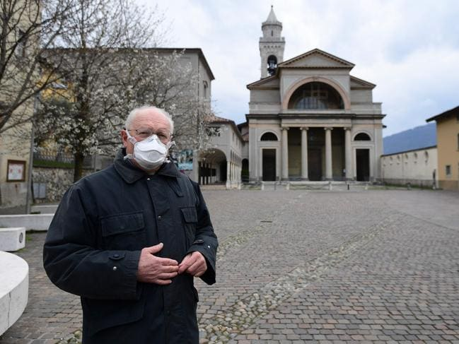 Italian priest, Don Giuseppe Locattelli, was charged with blessing the many dead in a northern region of the country that has been hardest hit by the coronavirus. Picture: AFP