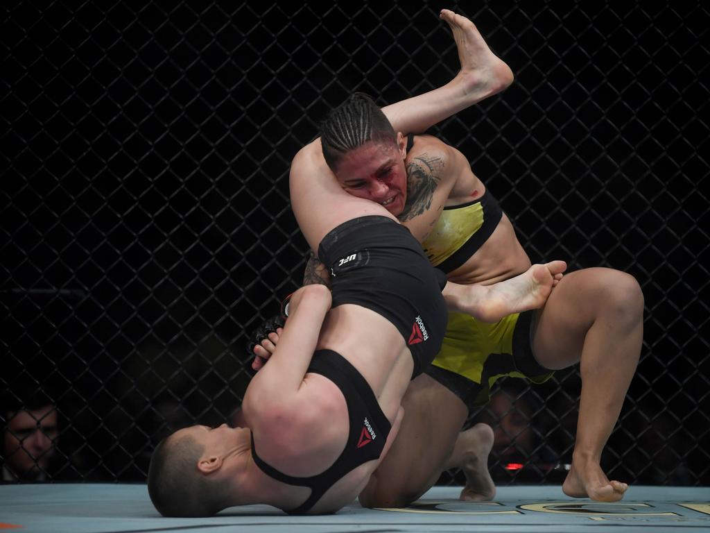 Andrade (r) grappling with Namajunas.