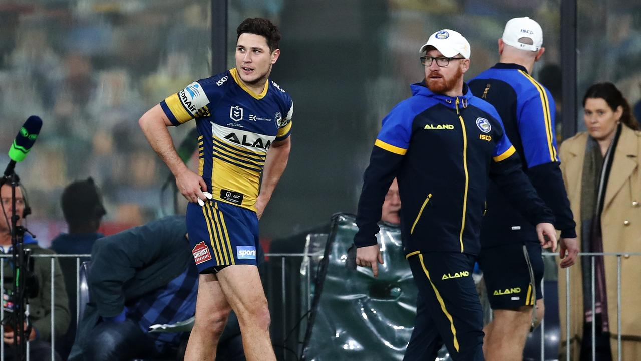 Mitchell Moses leaves the field with a calf injury
