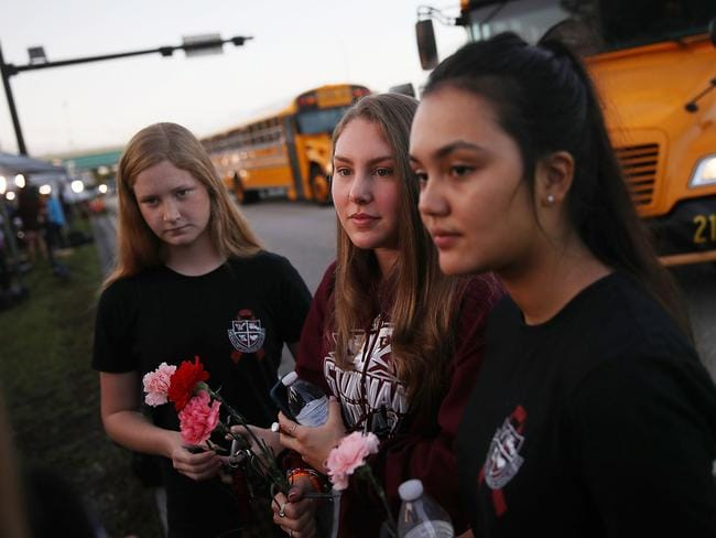 Students wore T-shirts in tribute to their late classmates and carried flowers. Picture: Joe Raedle/Getty Images/AFP