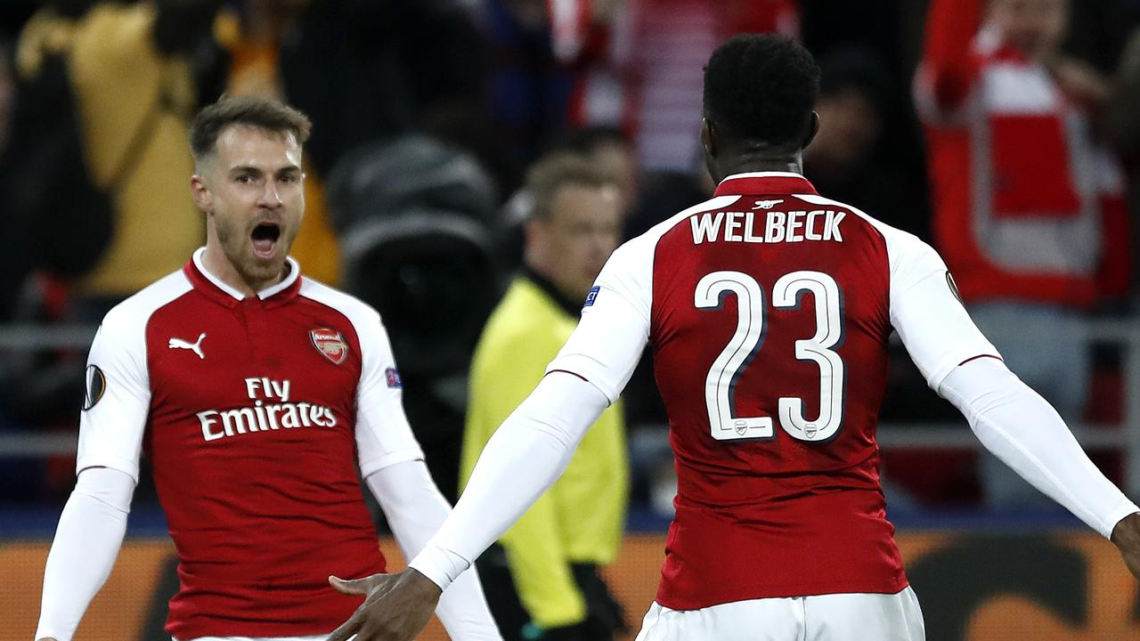 Arsenal's Aaron Ramsey, left, celebrates with Danny Welbeck after scoring his side's second goal