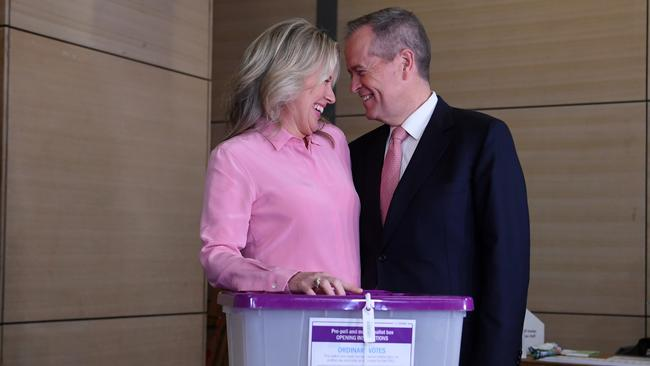 Bill Shorten and his wife Chloe react after casting their votes. Picture: AAP