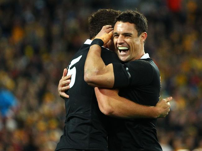 Israel Dagg and Dan Carter celebrate a try against the Wallabies.