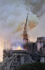 Flames and smoke rise as the spire on Notre Dame cathedral collapses in Paris, Monday, April 15, 2019. (AP Photo/Diana Ayanna)