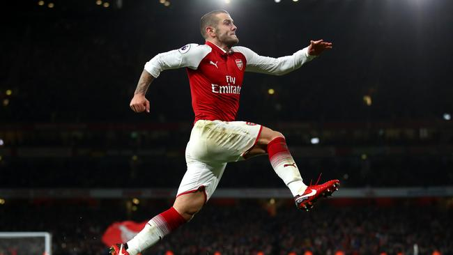 Jack Wilshere celebrates after scoring his sides first goal during the Premier League match between Arsenal and Chelsea