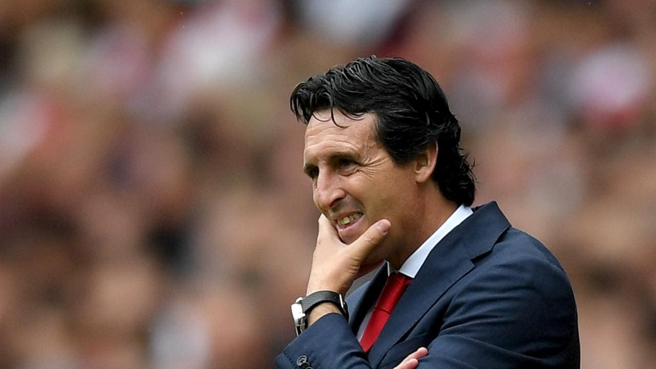 Unai Emery, Manager of Arsenal looks on