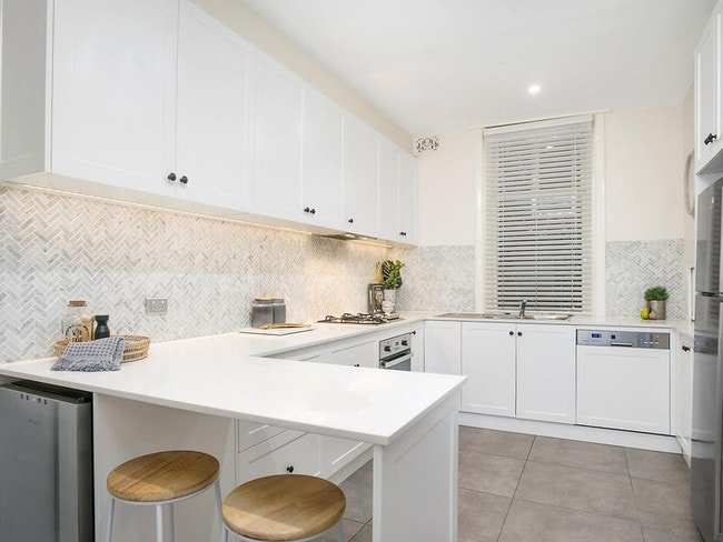 The kitchen is new and has a wine fridge and gas cooktop.