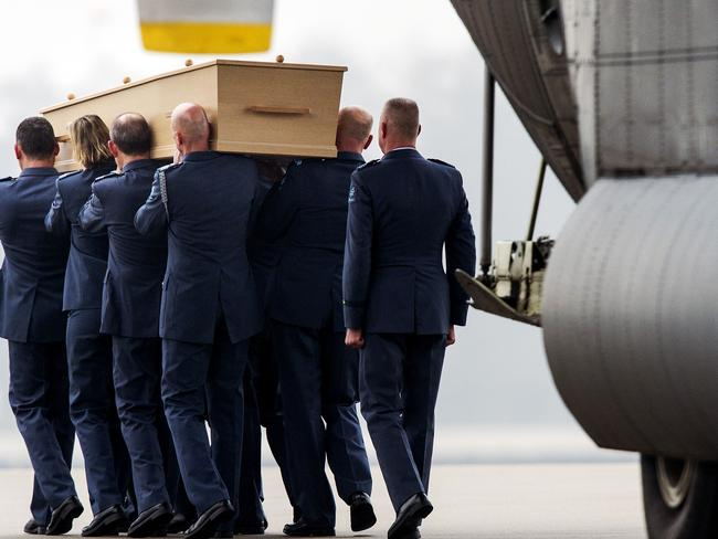 Coming home ... The remains of a victim of the MH17 air disaster are carried in ceremony after arriving by plane at the airport in Eindhoven on February 7, 2015. Picture: AFP/ ANP / Koen Van Weel