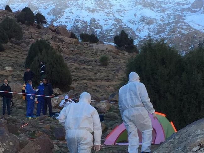 Forensic officers hike up to the crime scene in the High Atlas Mountains. Picture: 2M via AP