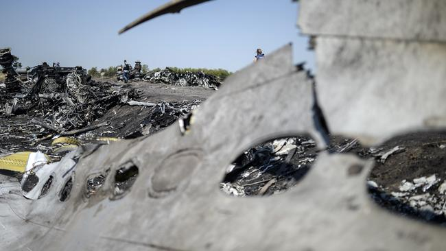 All that's left ... debris from the Malaysia Airlines plane at the crash site in eastern Ukraine. Picture: AFP.