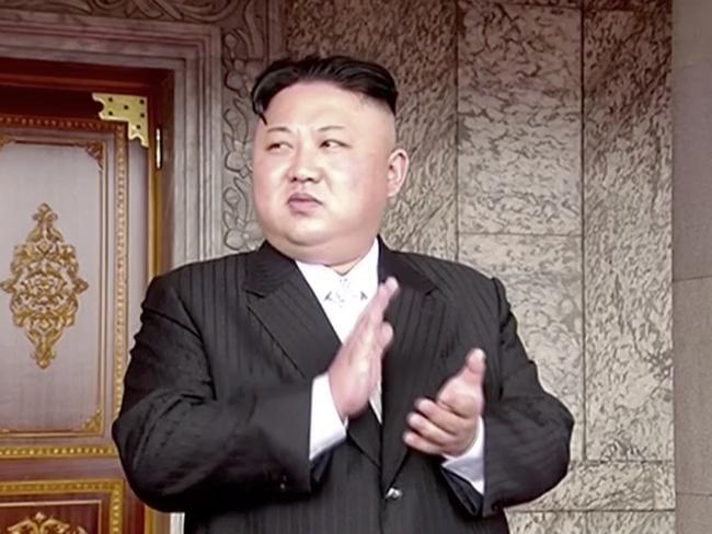 North Korea's leader Kim Jong Un applauds during the parade
