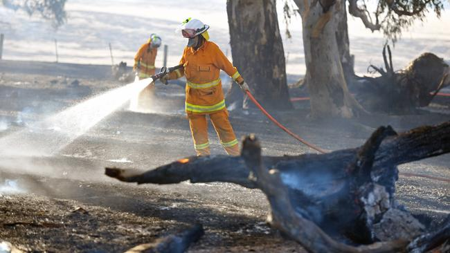 Firefighters at the scene of a bushfire in Birdwood, South Australia, yesterday. Picture: Tom Huntey