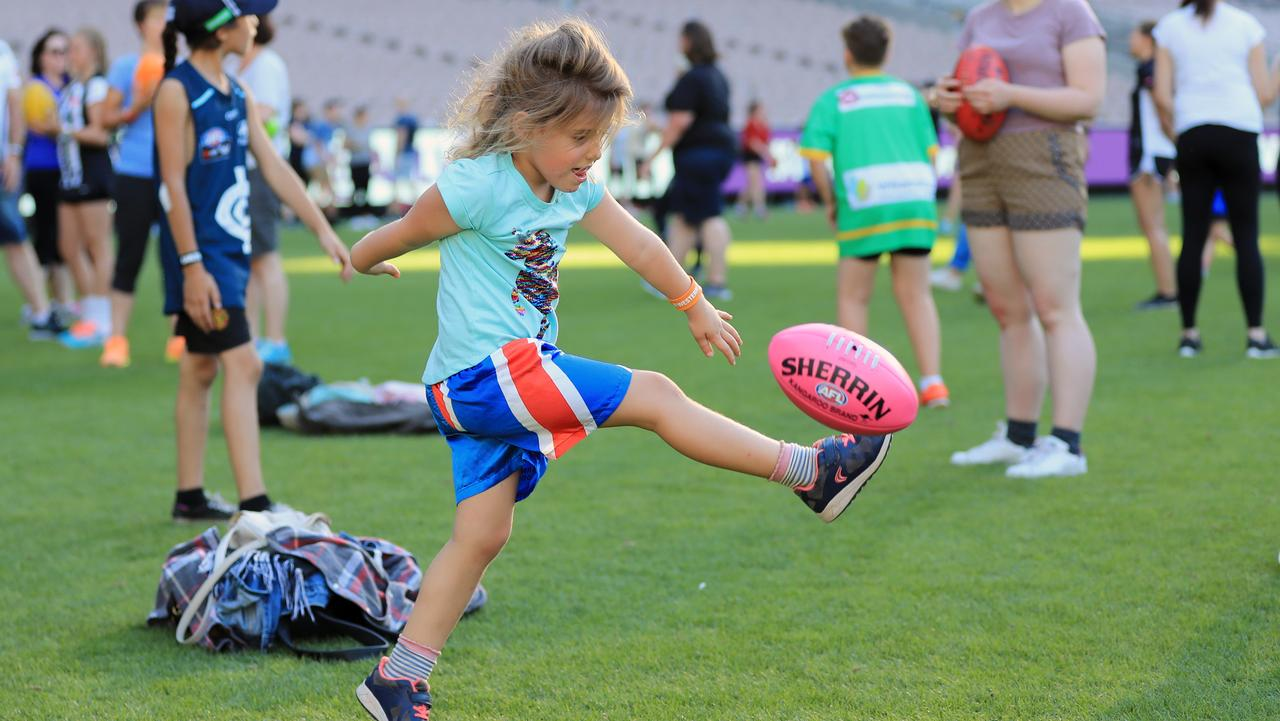Having a kick at the MCG. Picture: Alex Coppel