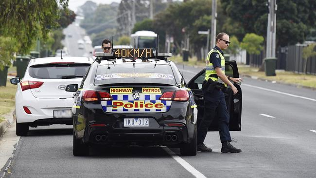 Victorian motorists re also required to slow to 40km/h when passing emergency vehicles. Picture: Alan Barber