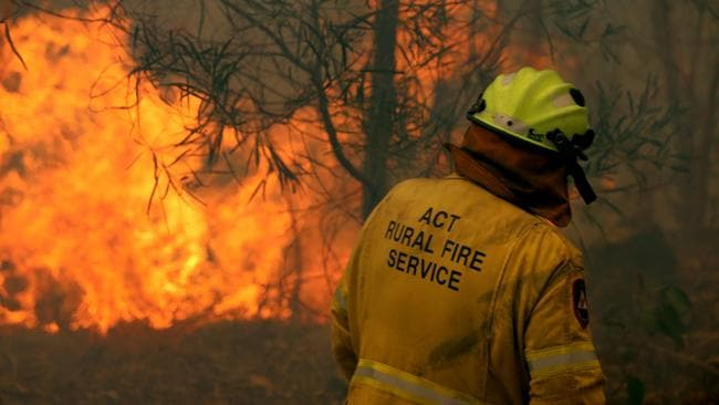 A strike team from the ACT RFS perform bushfire property protection at Telegraph Point north of Port Macquarie on the NSW mid north coast. Picture: Nathan Edwards.
