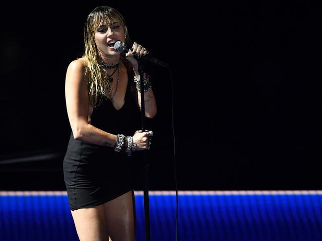 Miley Cyrus performs Slide Away at the VMAs. Picture: AFP