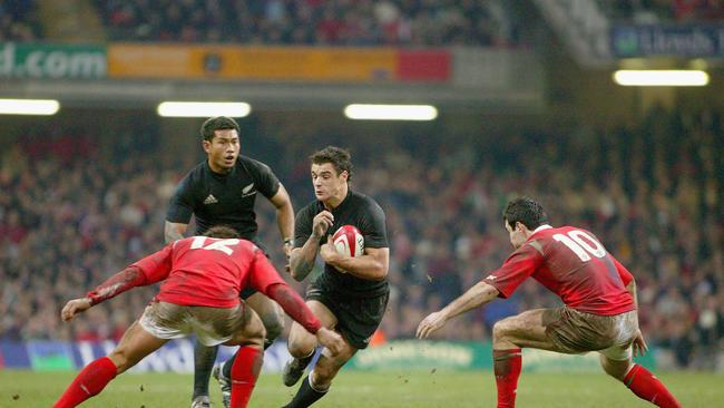 Dan Carter on the charge with Casey Laulala in support during Wales v All Blacks in 2004.
