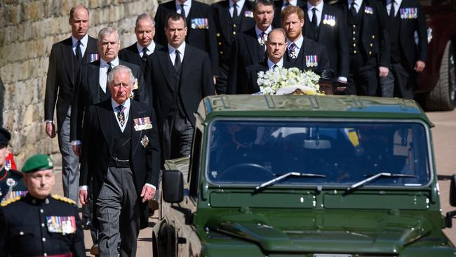 Members of the royal family follow the Land Rover carrying Prince Philip after his funeral. Picture: Leon Neal/Getty Images