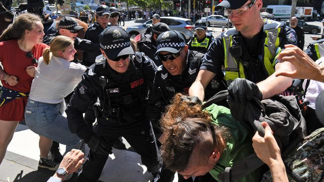 A protester is arrested. Picture: William West/AFP