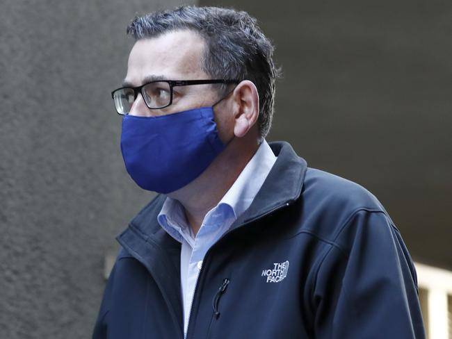 Mr Andrews wore a face mask to this morning's press conference, removing it to address the media. Picture: Photo by Darrian Traynor/Getty Images
