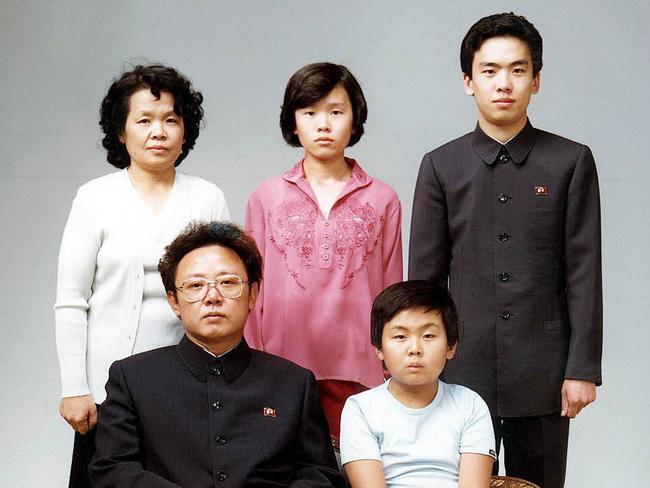 A file photo taken in August 1981 of Kim Jong-nam (R, front row), the half brother of North Korean leader Kim Jong-un, together with his father (L, front row), late North Korean leader Kim Jong-il. Picture: AAP
