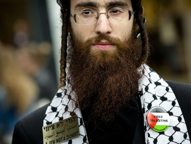 A member of Neturei Karta, a fringe ultra-Orthodox movement in Israel demonstrates against the country's military operation in Gaza. Pic: AFP.