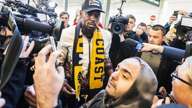 Usain Bolt arriving at Sydney International airport ahead of his trial today with the Central Coast Mariners. Picture: Jenny Evans