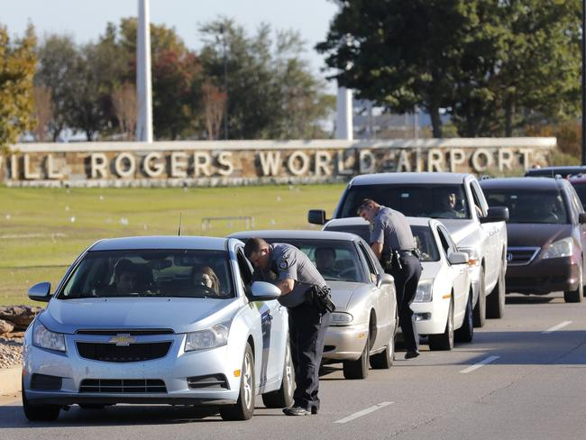 Oklahoma City police officers gather information from vehicles leaving Will Rogers World Airport. Picture: Steve Gooch/The Oklahoman.