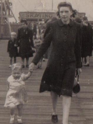 Elaine holding on to her mum's hand in Blackpool in the 1940s.