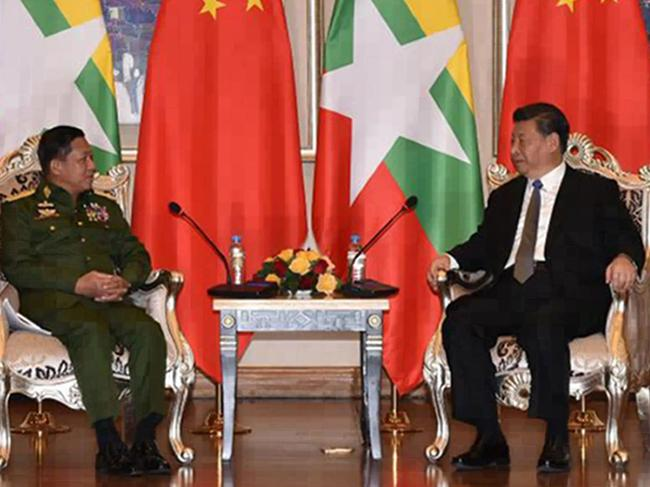 Myanmar's army chief, Senior General Min Aung Hlaing (L) speaking with Chinese President Xi Jinping, during their meeting. Picture: AFP Photo