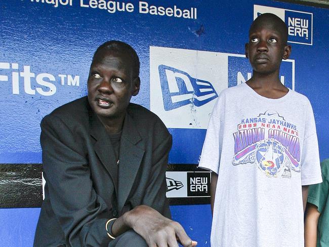 Former NBA player Manute Bol, with his son Bol Bol, at a Kansas City Royals baseball game in 2008.