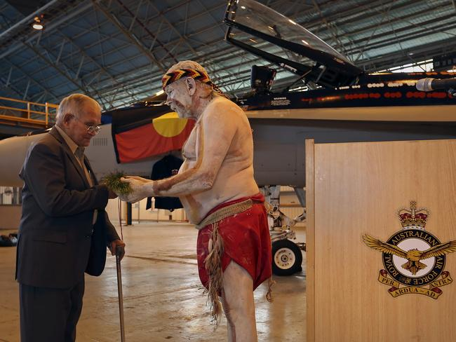 Kevin Waters, the younger brother of Warrant Officer Len Waters, receives a welcome to country gift, from Bryon Powell, of the Wathaurong People, as part of the unveiling of the Worimi F/A-18A Hornet. Picture: Air Force Images.