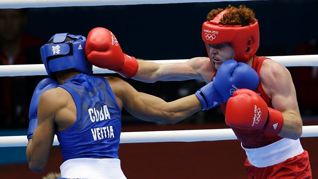Cuba's Yosbany Veitia Soto, left, fights Australia's Billy Ward during a light flyweight 49-kg preliminary boxing match.