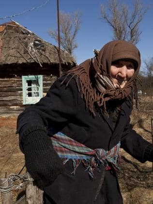 Kharytina Desha, 92, is one of the few people who has returned to her home inside the Exclusion Zone.