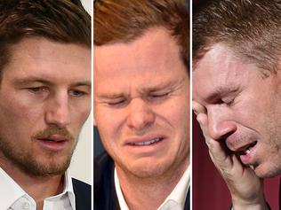 """COMPOSITE IMAGE - Cameron Bancroft, Steve Smith and David Warner. TOPSHOT - Cricketer Steve Smith reacts at a press conference at the airport in Sydney on March 29, 2018, after returning from South Africa. Distraught Australian cricketer Steve Smith on March 29 accepted full responsibility for a ball-tampering scandal that has shaken the sport, saying he was devastated by his """"big mistake"""". / AFP PHOTO / PETER PARKS / -- IMAGE RESTRICTED TO EDITORIAL USE - STRICTLY NO COMMERCIAL USE --"""